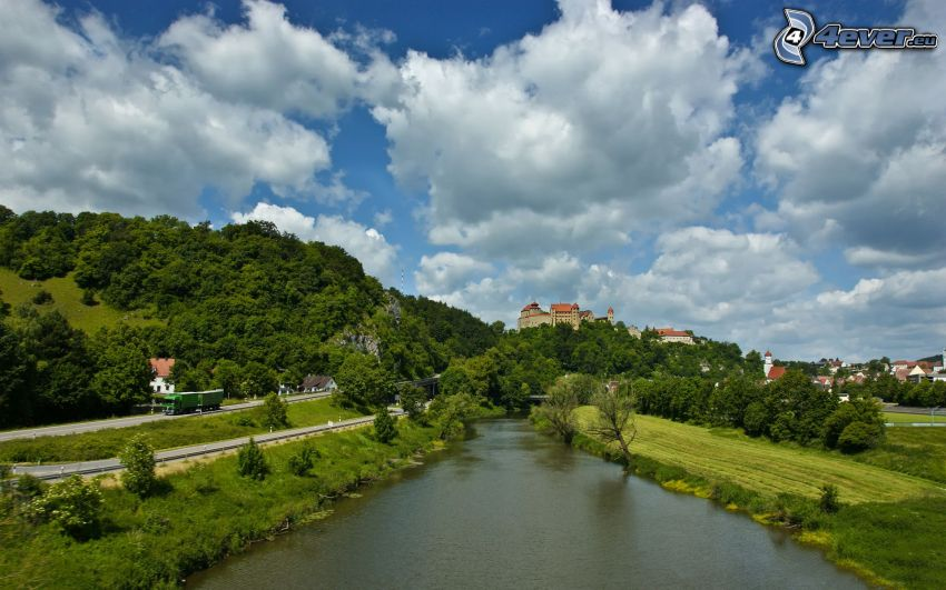 River, green trees, castle, clouds
