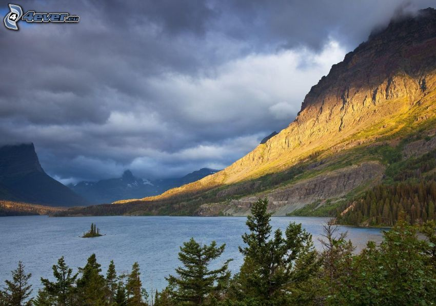 rocky hill, lake in the forest, coniferous trees, Banff National Park