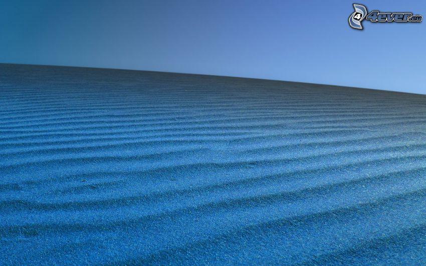 sand, blue background