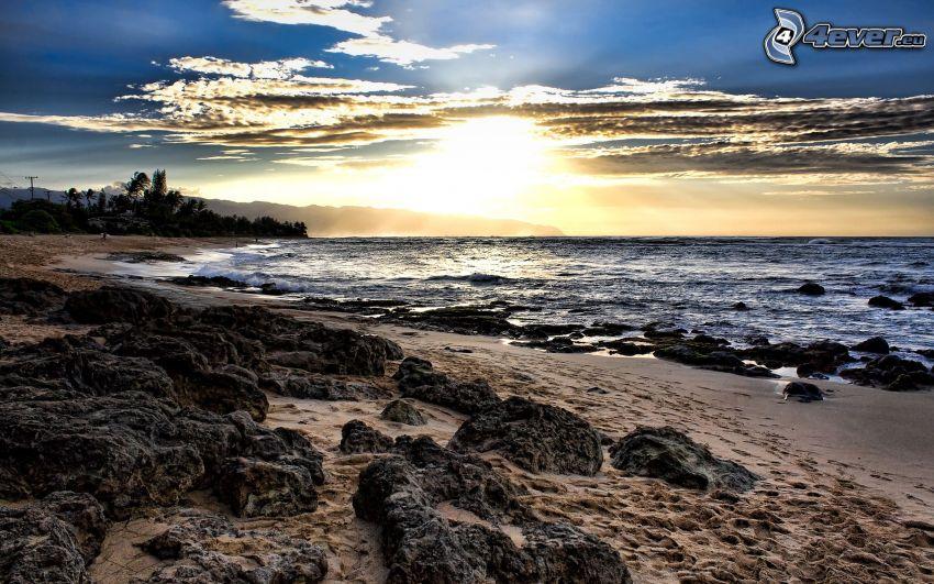 beach at sunset, rocky coast, sea