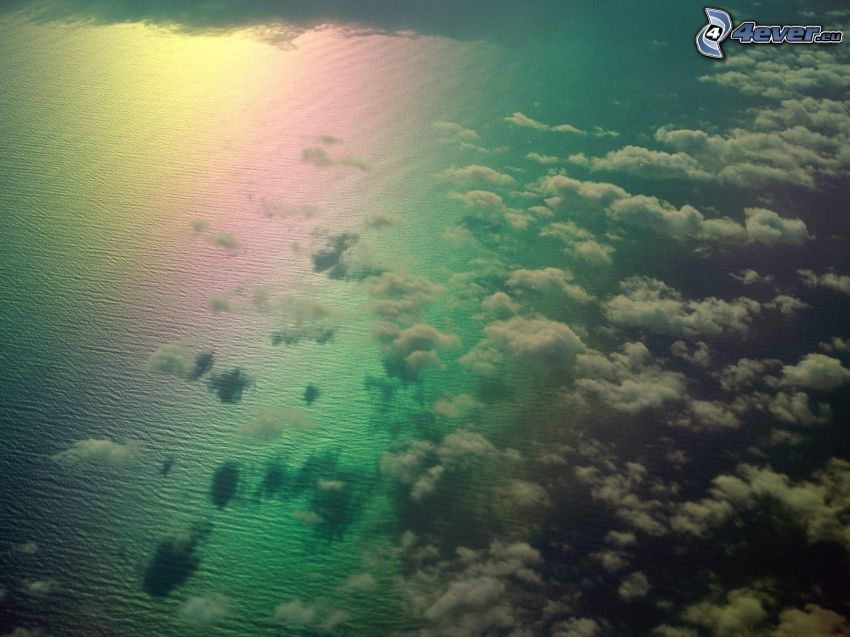 clouds over sea, rainbow colors, over the clouds