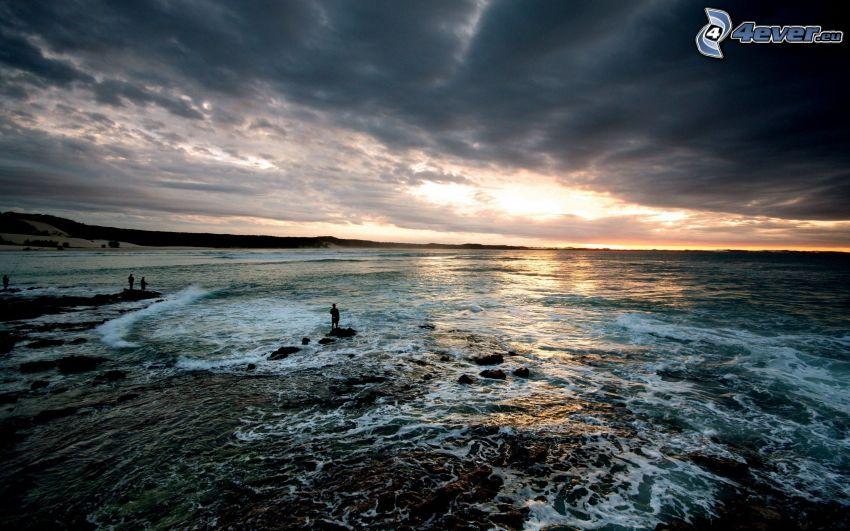 dark clouds over the sea, coast