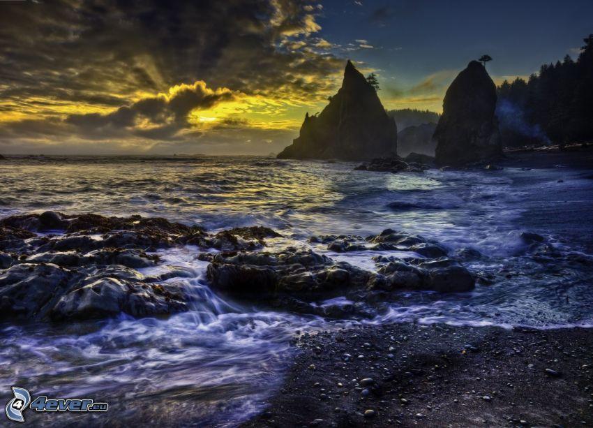 dark sunset, rocky beach, sunset over the sea