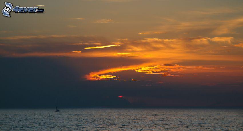evening sky, boat at sea