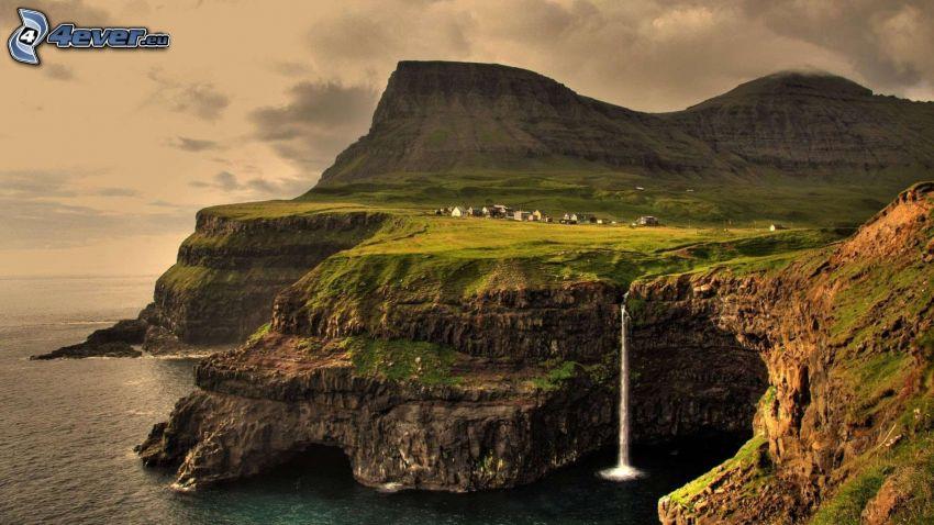 Faroe Islands, rocky shores, coastal reefs, waterfall, greenery, sea