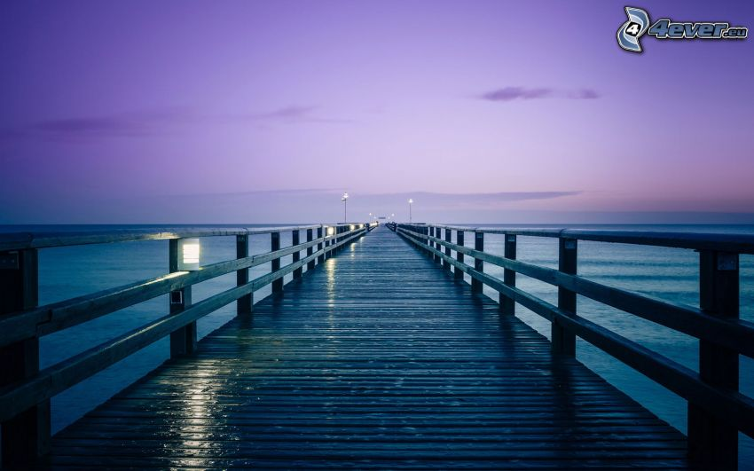 long pier, purple sky