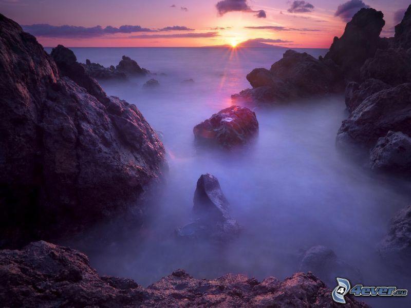 Maui, rocks in the sea, sunset behind the sea