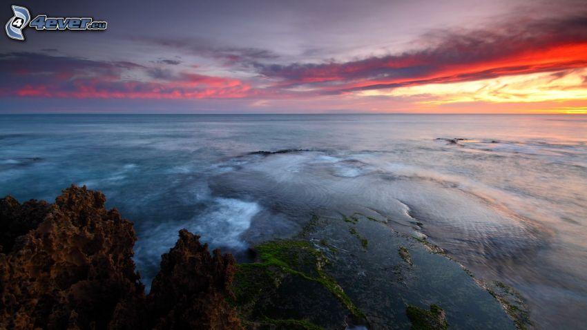 open sea, evening sky, rocks