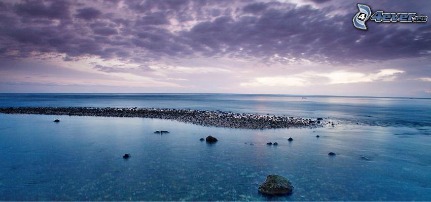 open sea, purple sky, rocky coastline