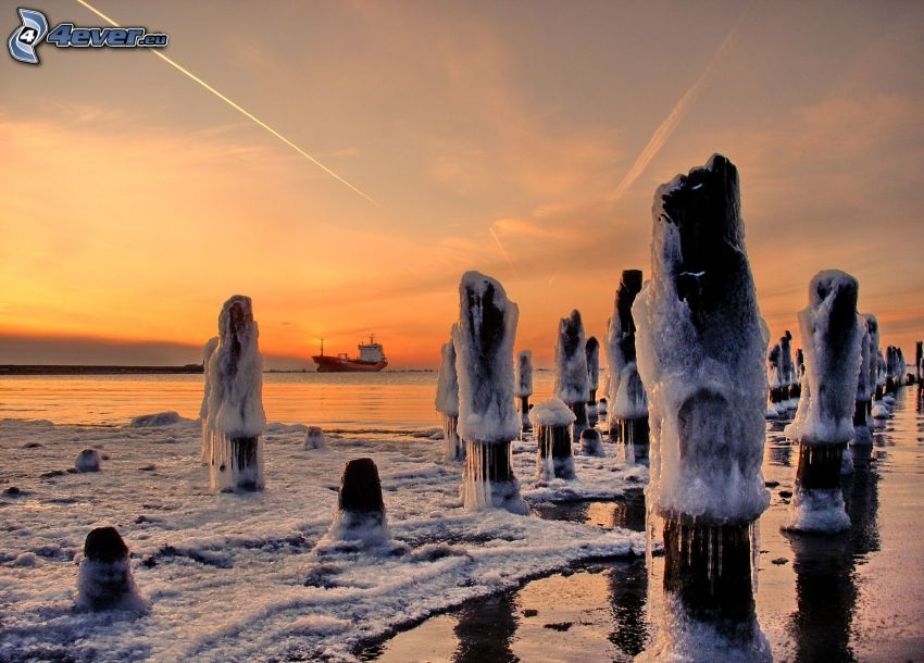 pillars, frozen sea, orange sky, freighter, contrail