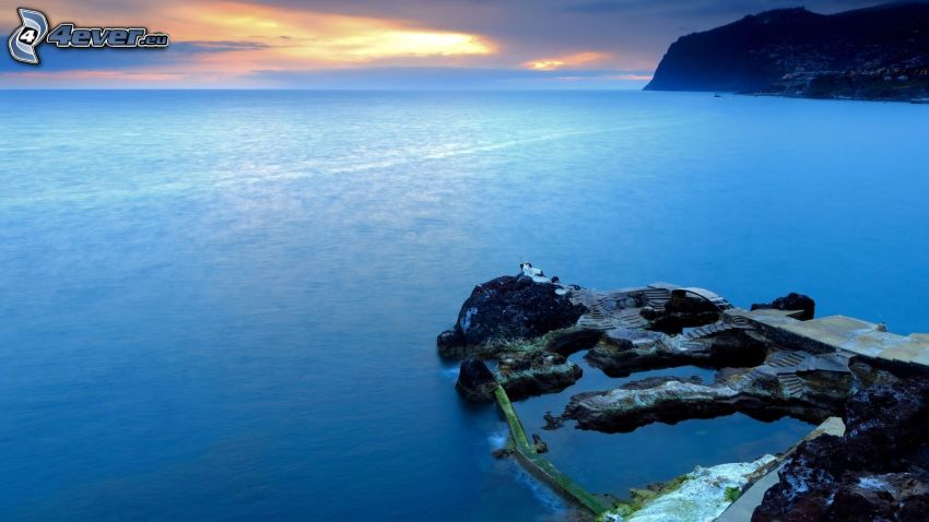 rocks in the sea, evening beach
