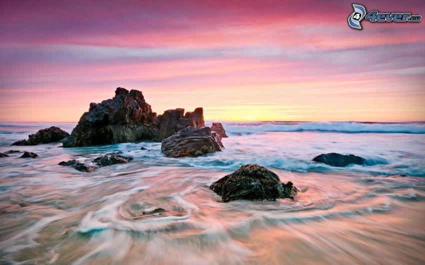 rocks in the sea, evening sky