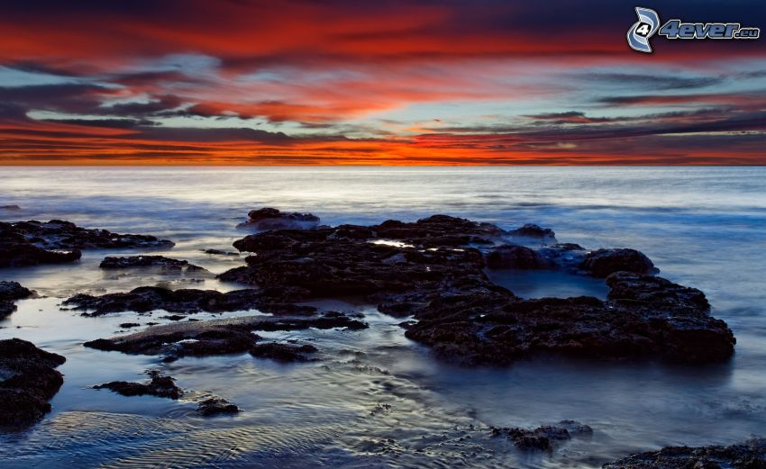 rocky beach, evening sky