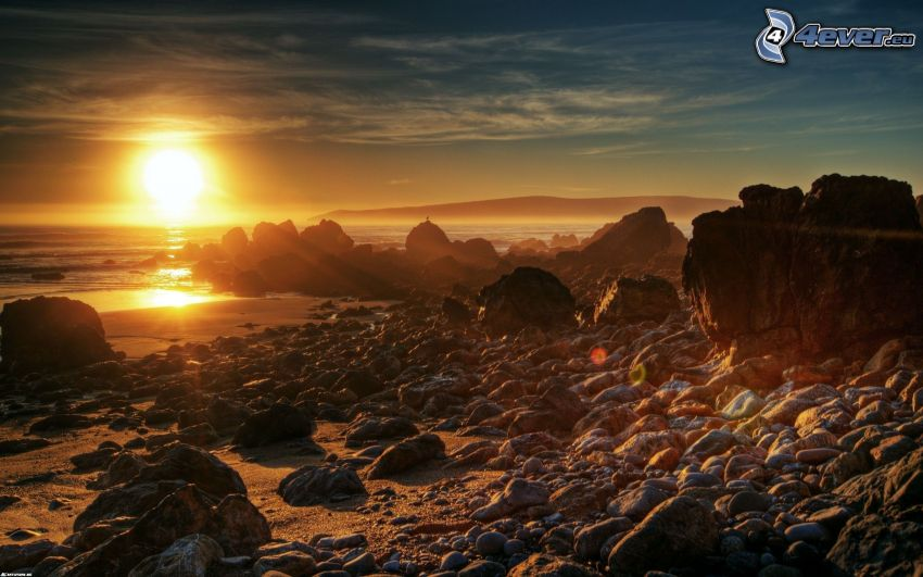 rocky coastline, beach at sunset