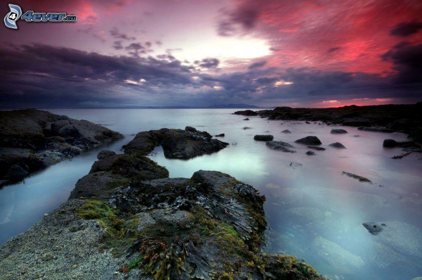 rocky coastline, pink sky