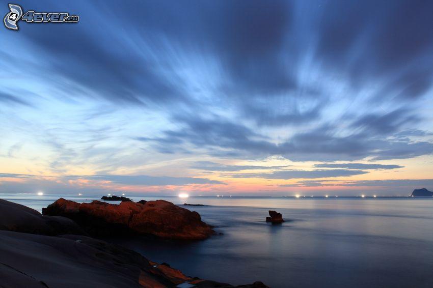 rocky coastline, sea, sky, lights