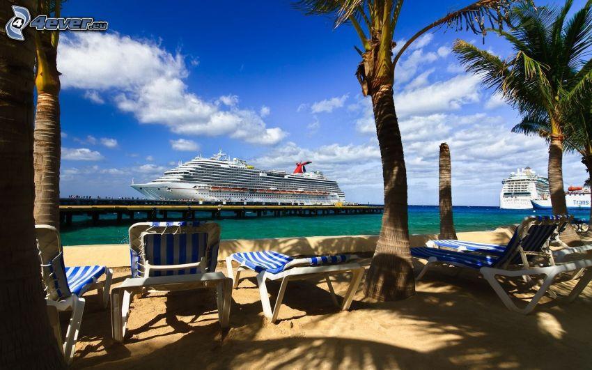 sandy beach, deck chairs on the beach, palm trees, ships