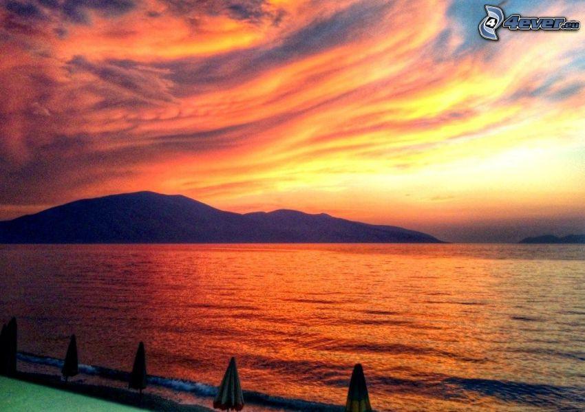 sea, after sunset, orange sky, island
