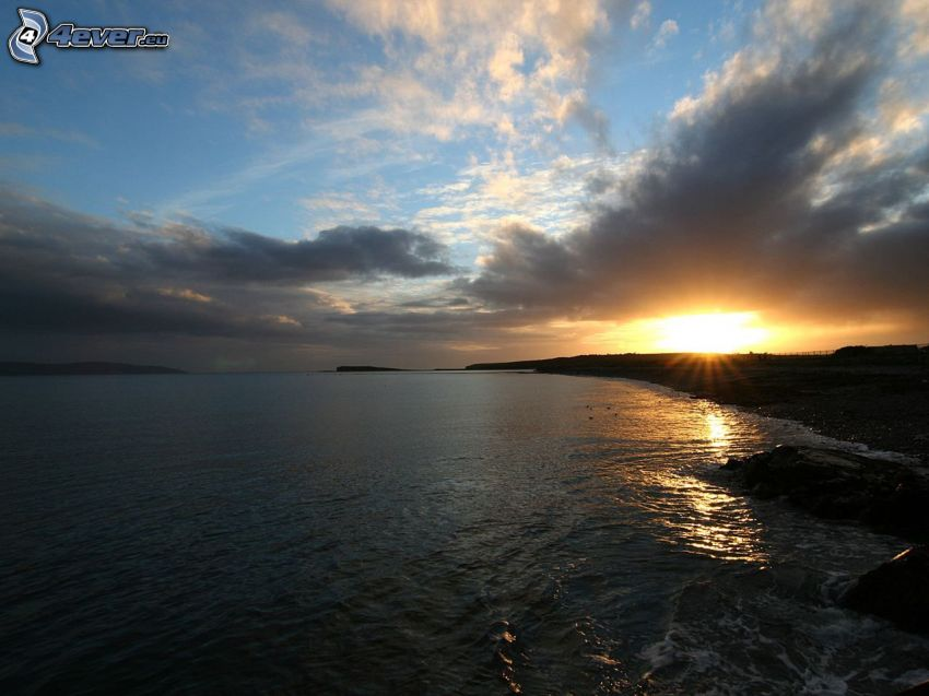 sea, beach at sunset