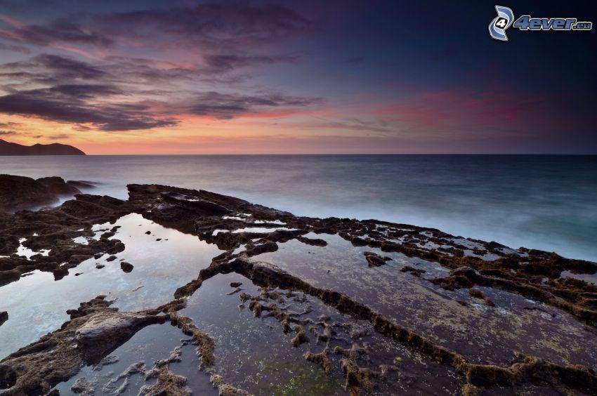 sea, rocky coastline, evening sky