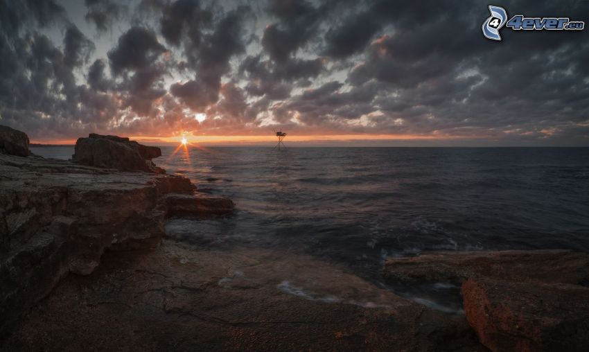 sunrise at sea, rocky shores, clouds