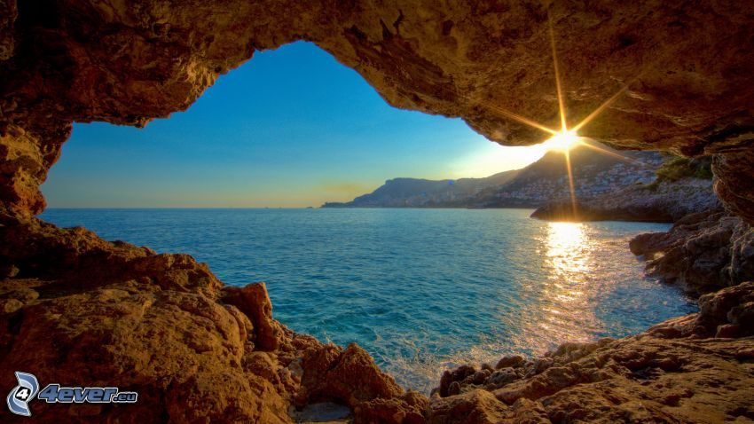sunset at sea, rocky beach, the view of the sea