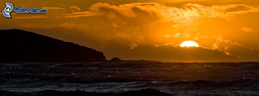 sunset behind the sea, clouds, yellow sky