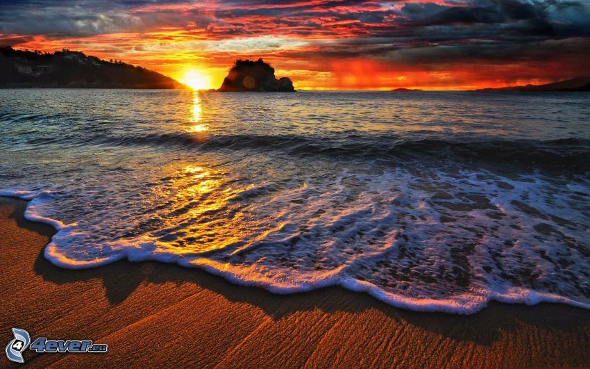 sunset behind the sea, evening beach, dark sky