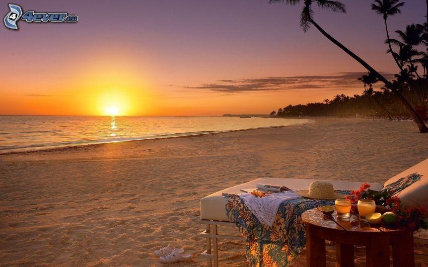 sunset behind the sea, evening beach, sandy beach, vacation