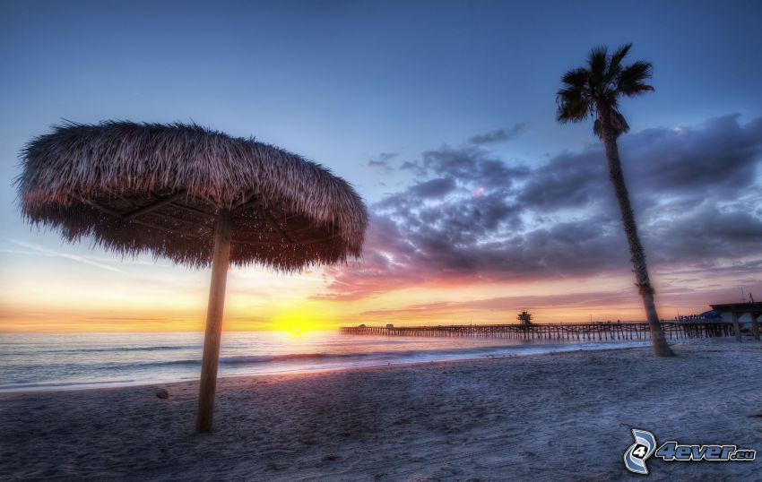 sunset over ocean, parasol on the beach, palm tree, HDR, pier