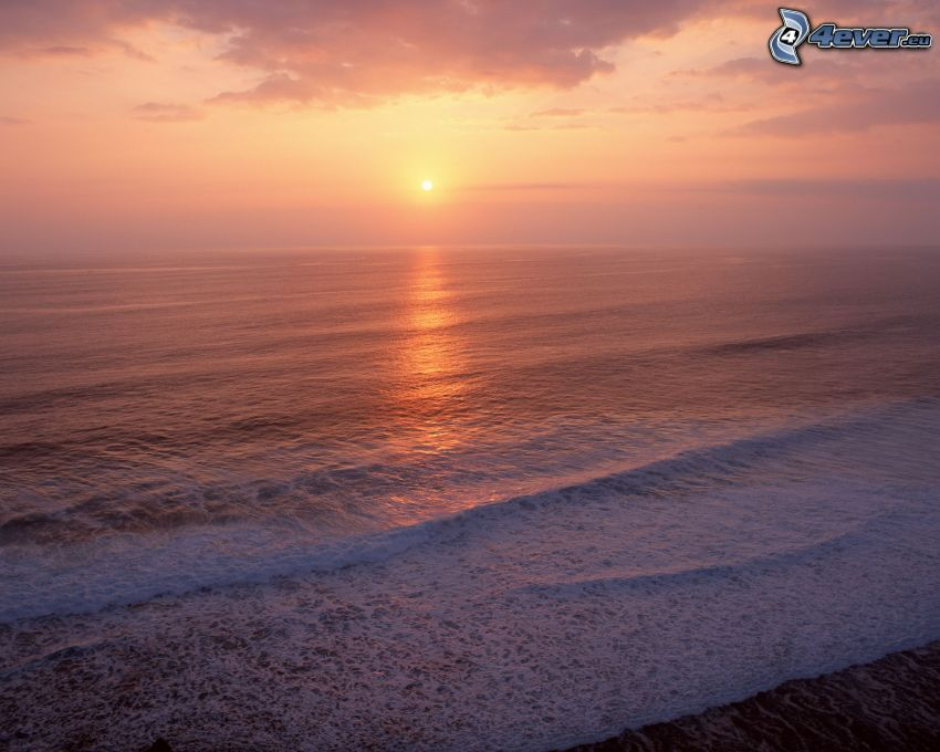 sunset over ocean, sea, waves on the shore