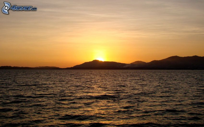 sunset over the sea, mountain