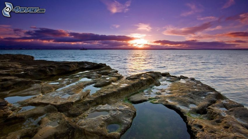 sunset over the sea, rocky coastline