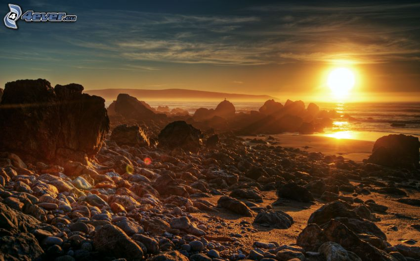 sunset over the sea, rocky coastline