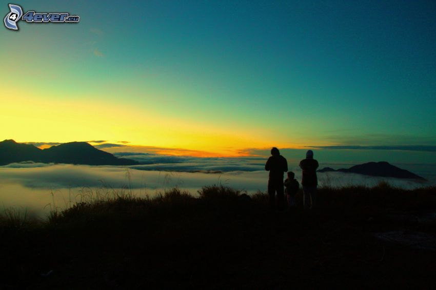 silhouettes of people, over the clouds, sunset