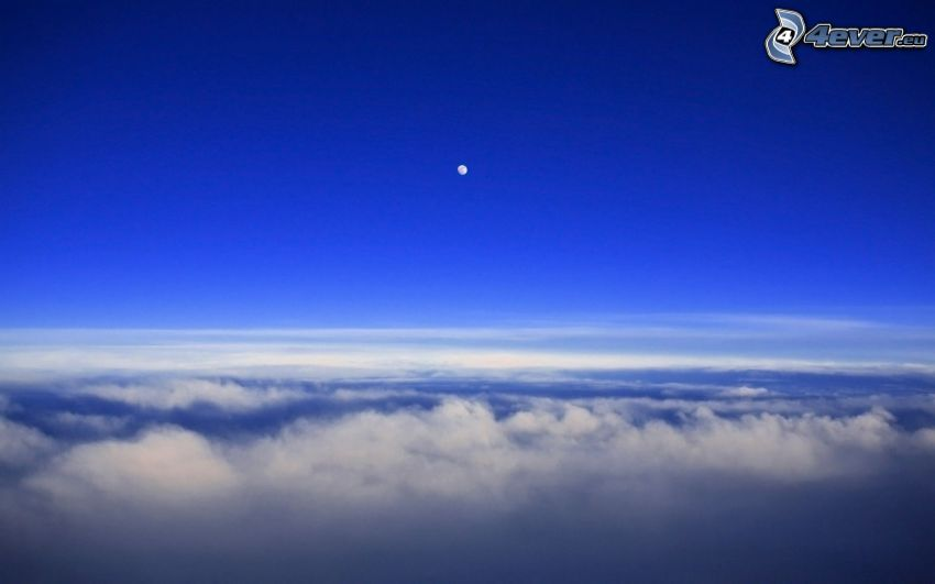 over the clouds, moon