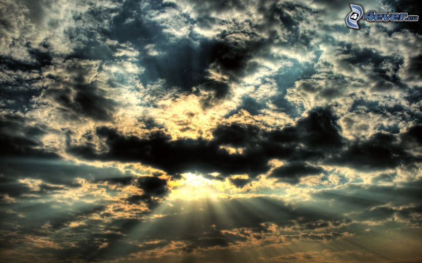sunbeams behind clouds, dark clouds