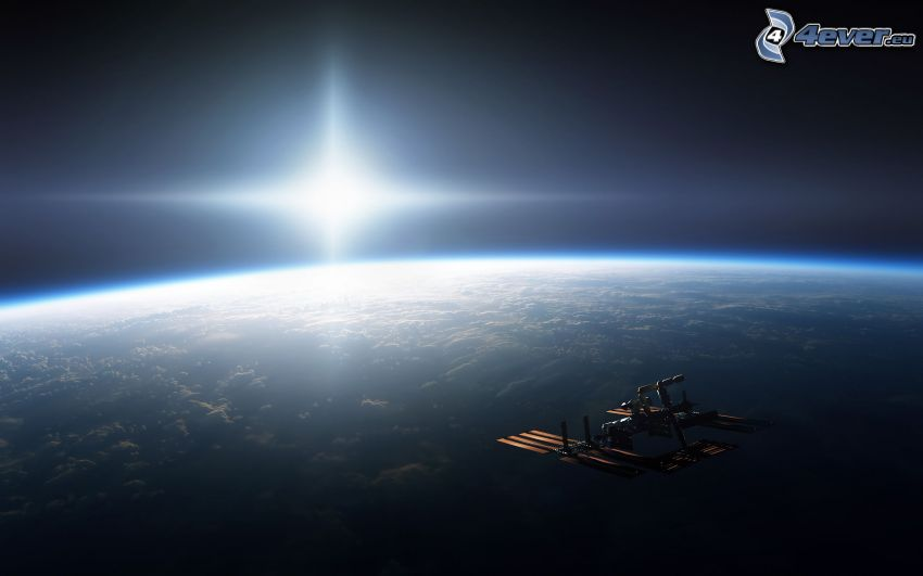 ISS over Earth, sun