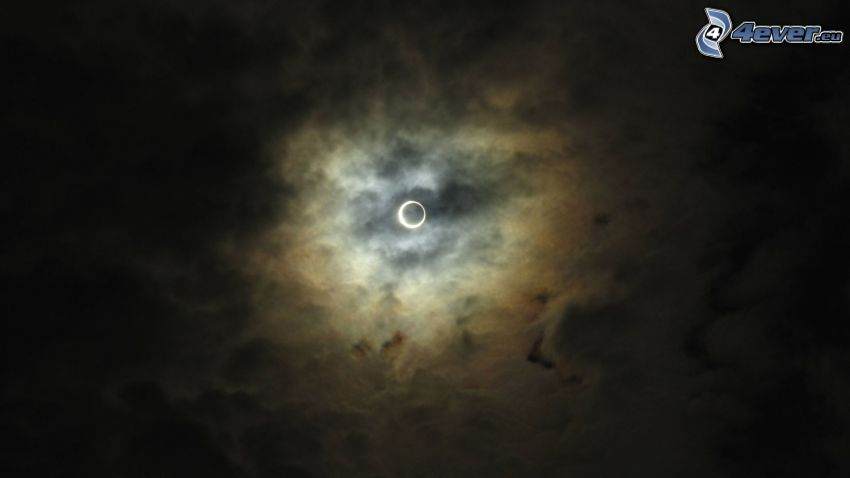 solar eclipse, sun behind the clouds