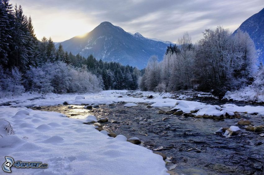 winter landscape, winter river, snowy forest, sunset behind the mountains