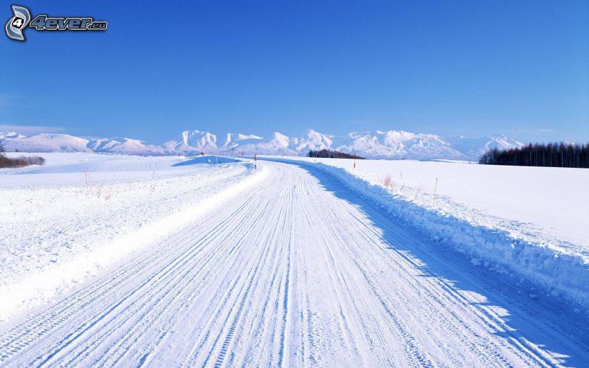 winter road, meadow, snowy mountains