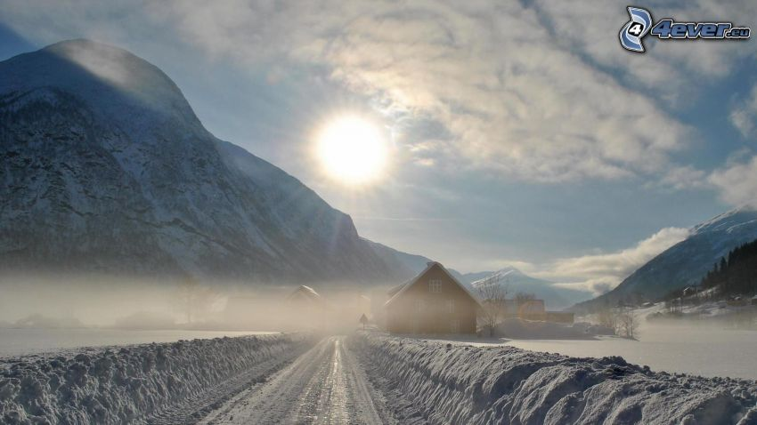 winter road, snowy mountains, sun, cottages