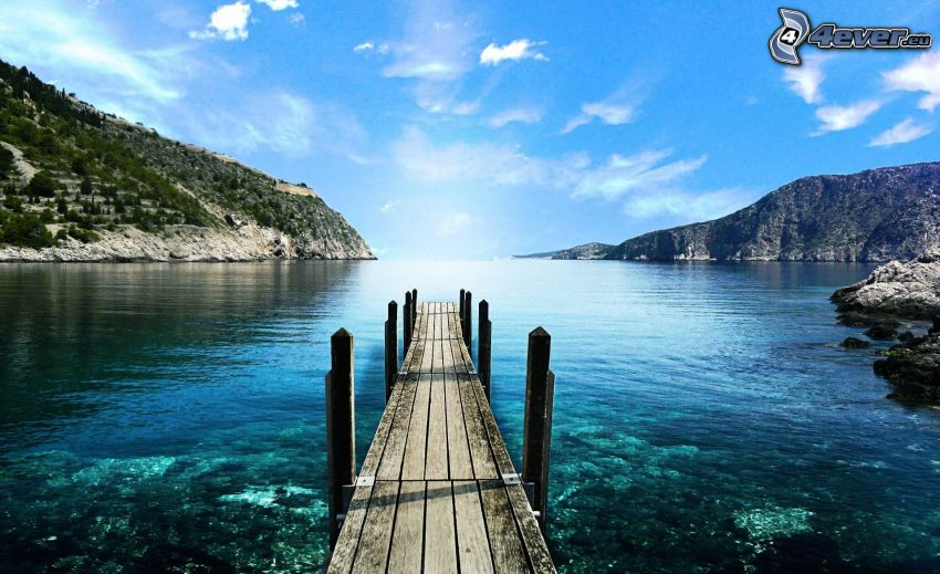 wooden pier, lake, rocky hills