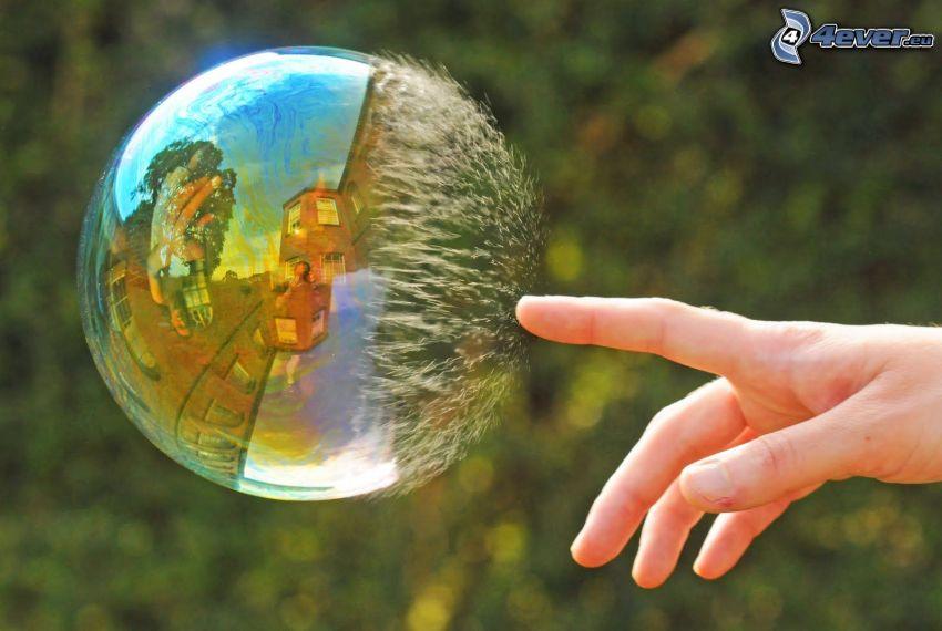 bursting bubble, hand
