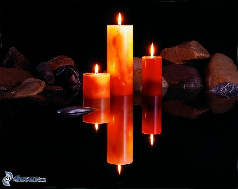 candles, rocks, reflection