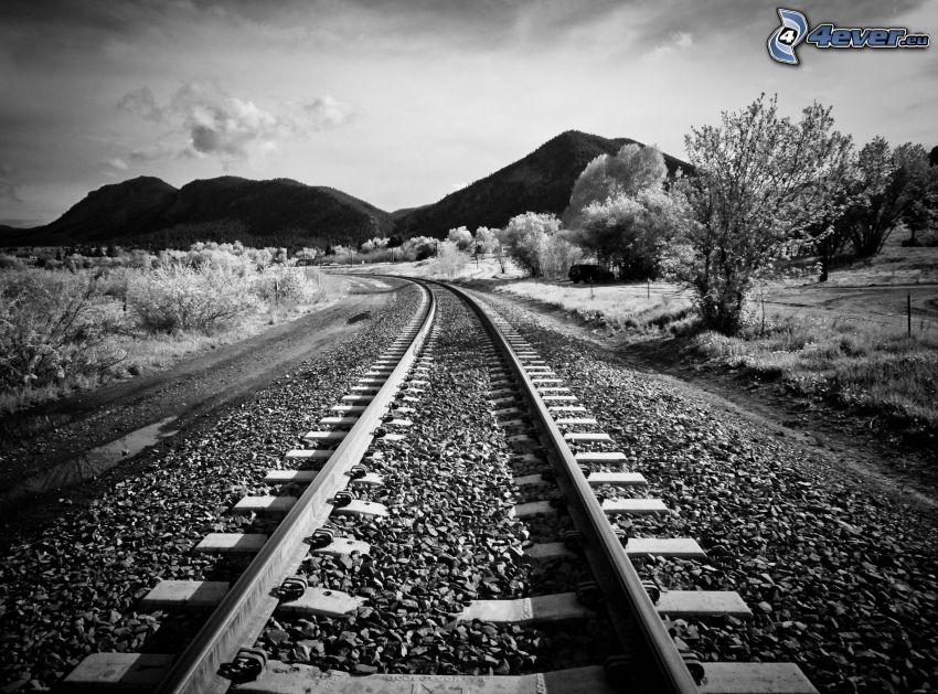 rails, rocks, hills, black and white