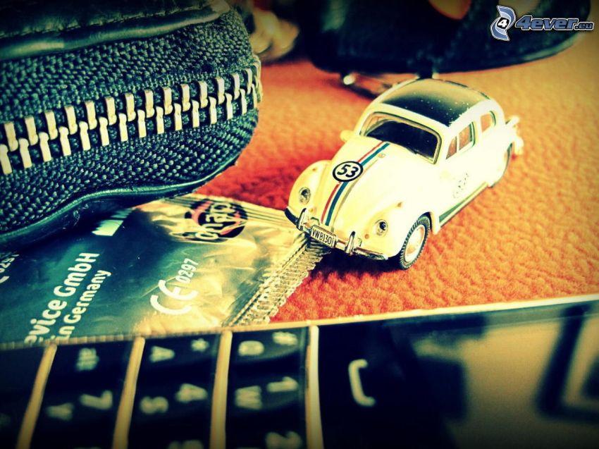 Volkswagen Beetle, matchbox car, phone
