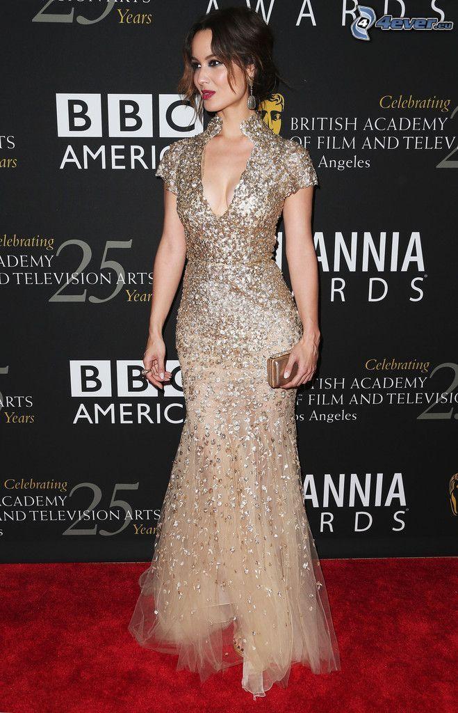 Alice Evans, gold dress