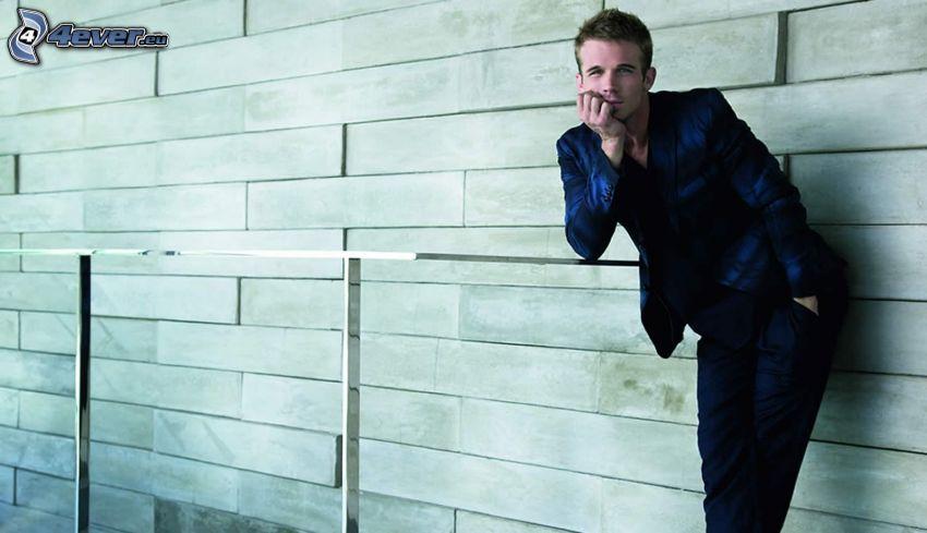 Cam Gigandet, man in suit, railing