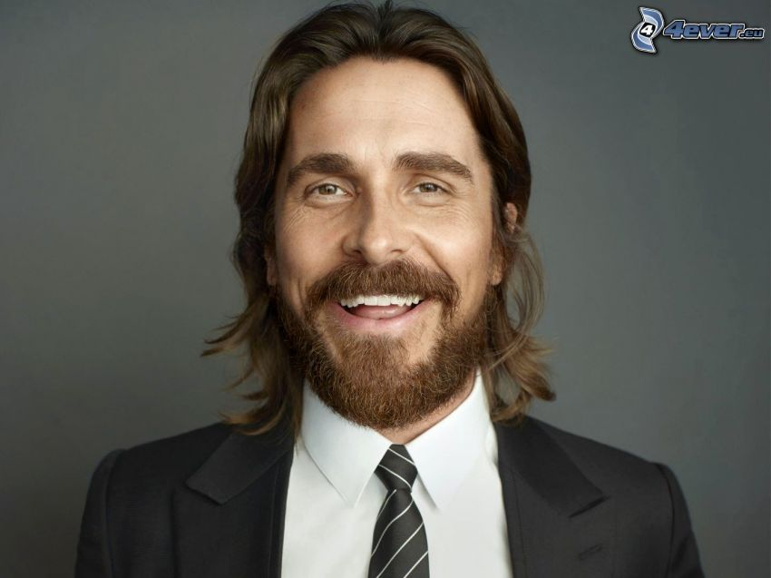 Christian Bale, whiskers, man in suit, laughter